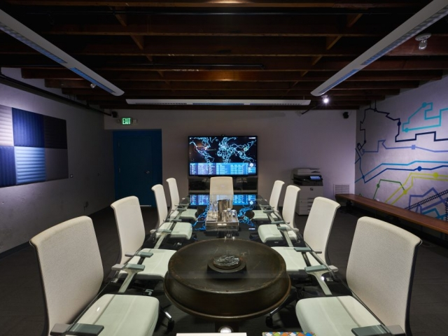 Photo of Kinetic's conference room at night.