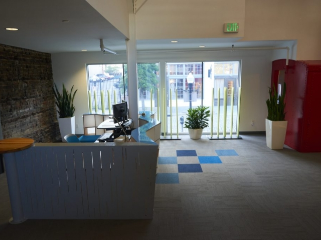 Photo of Kinetic's front desk behind the boxcar.